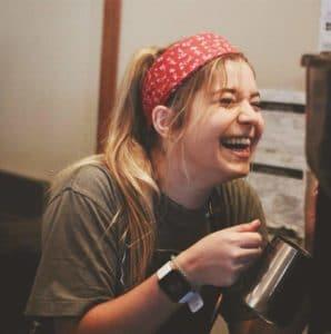 Teresa steaming milk as a barista